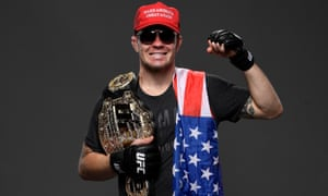 Colby Covington poses with a Make America Great Again cap at UFC Fight Night