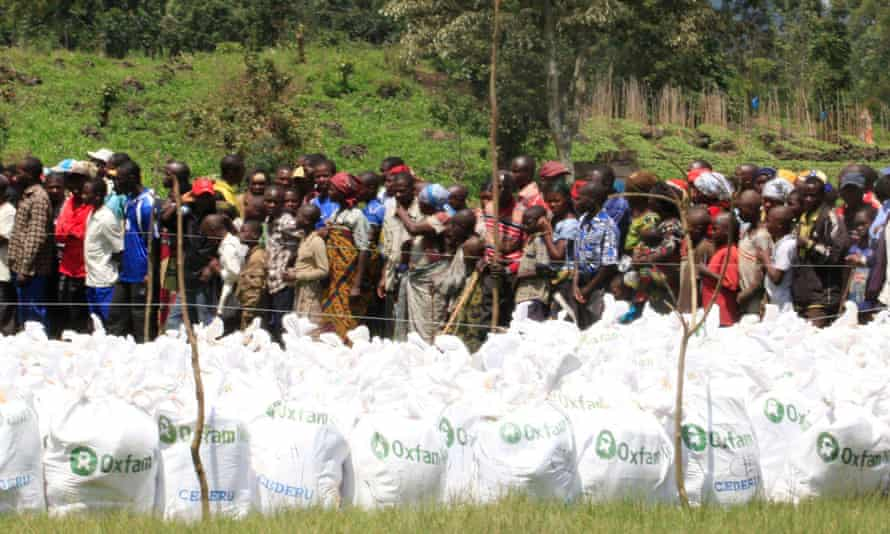 Displaced Congolese people gather to receive food relief distributed by Oxfam in Rushuru town, Democratic Republic of Congo, in 2012.