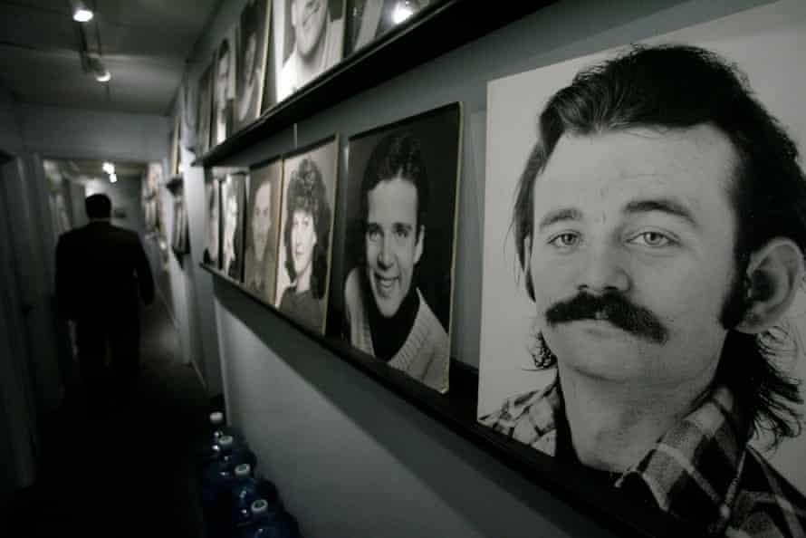 A moustachioed Bill Murray, right, on The Second City comedy club's wall of fame in Chicago.