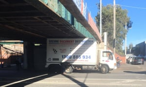 A truck wedged under the Montague Street bridge in Melbourne.
