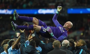 Manchester City's goalkeeper Willy Caballero is lifted by his team-mates after wining the penalty shoot out in the Capital One Cup Final.