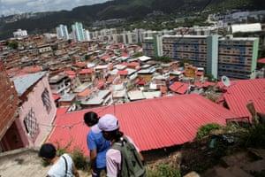 Healthcare workers go door to door to inoculate elderly and disabled people against coronavirus in Caracas, Venezuela