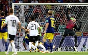 Goalkeeper Robin Olsen of Sweden makes a reflex save.