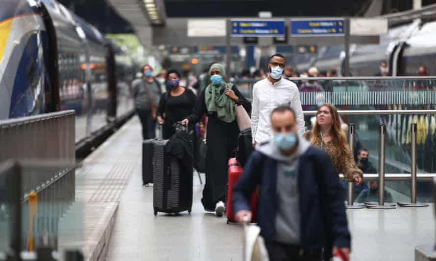 Travellers arrive at St Pancras station in London from France