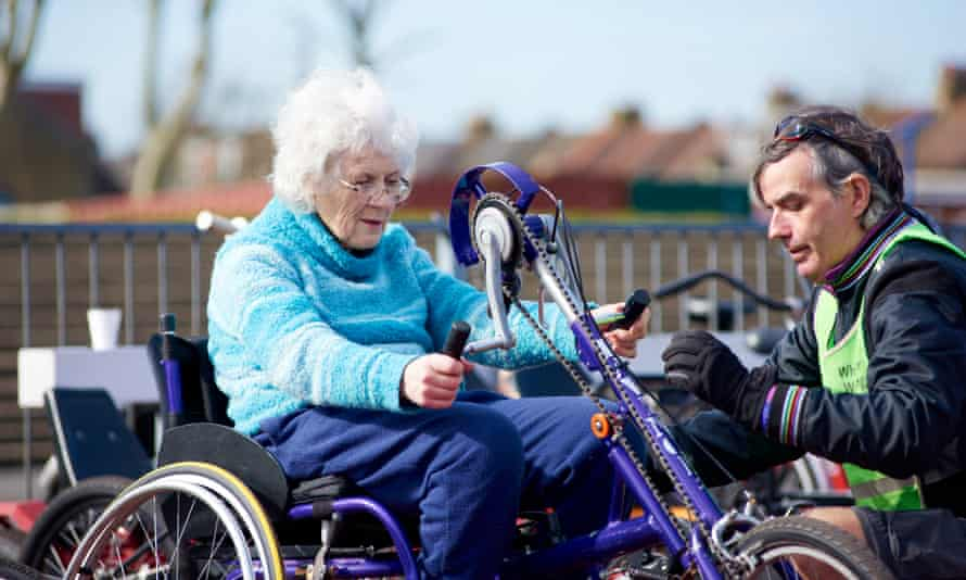Elderly woman on a tricycle