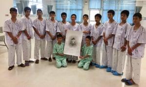 The boys pose around a drawing of Saman Kunan.