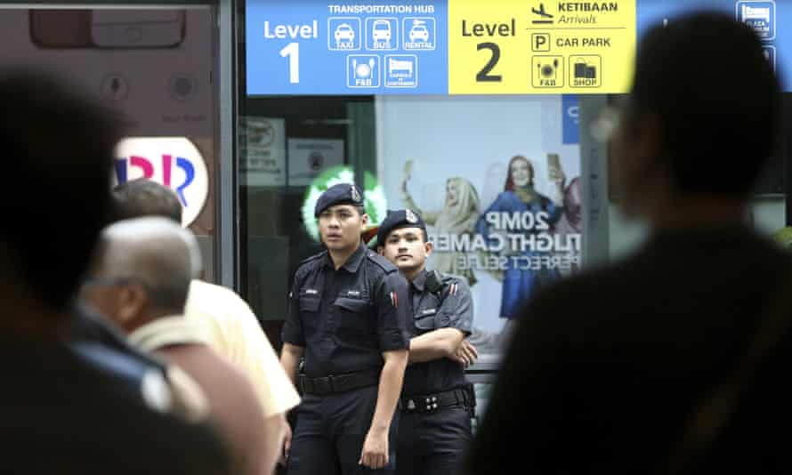 Police officers patrol inside the Kuala Lumpur airport after the assassination of Kim Jong-nam.