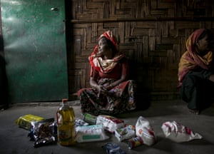 A woman with unpacked supplies in the Leda camp