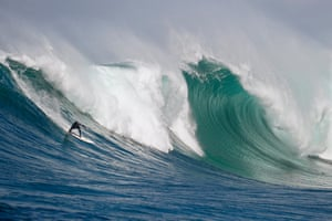 South African James Taylor surfs a huge wave on an offshore reef as part of the Rebel Sessions display. Surfers rode waves as tall as five metres (16ft), some with 20-second wave periods