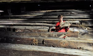 Cleaning the timbers of HMS Namur