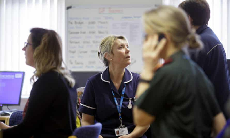 Intermediate care nurse Jackie Goldsmith discusses a patient's case during a team meeting at Westhaven hospital