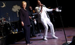 Democratic U.S. presidential candidate Clinton joins singer Wilson on stage during a get-out-the-vote concert in support of her at the Music Farm in Charleston, South Carolina.