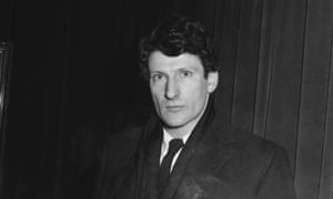 Lucian Freud pictured in black and white wearing a smart coat and tie in 1958.