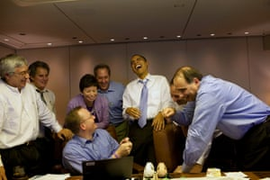Nov 2009 Obama jokes with staff before the Summit of the Americas in Singapore