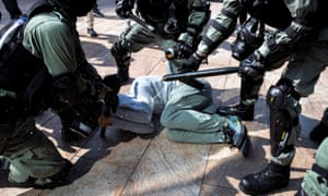 Riot police detain a protester in Hong Kong