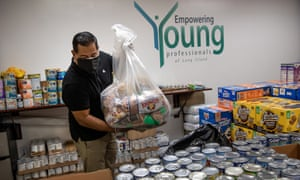 Luis Mendez organizes food boxes to send to minorities in need during the Covid-19 lockdown in Garden City, New York.