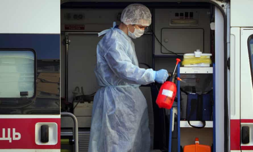 A medical worker sprays disinfectant in an ambulance after delivering a patient suspected of being infected with coronavirus to the Pokrovskaya hospital in St Petersburg, Russia, on 4 May.