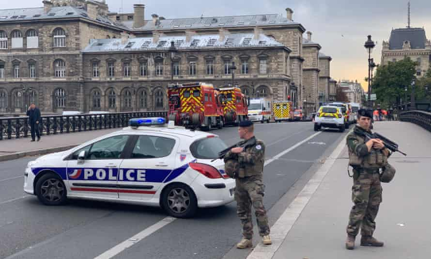Soldiers stand guard near the site of Thursday's knife attack at the police headquarters in Paris.