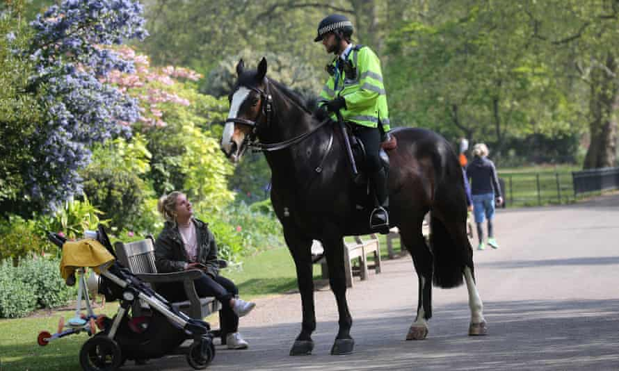 Police patrolling St James Park during the lockdown. Photograph: Isabel Infantes/Getty Images