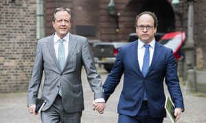 Politician Alexander Pechtold, leader of the Democrats 66 party, holding hands with his colleague, Wouter Koolmees.'