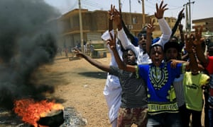 Anti-government protesters at a barricade in Khartoum last week. More than 120 protesters were killed on Monday.