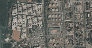 The original Mahul village (bottom left) and the 72 tower blocks (top left), near the area's oil refineries and heavy industry.
