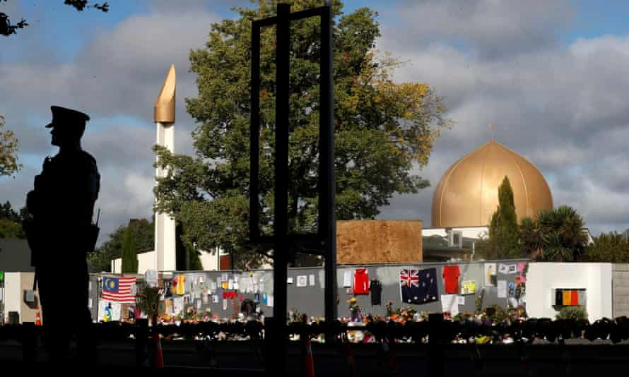 A police officer stands guard outside al Noor mosque in Christchurch a week after the mass shooting in which 51 people died.