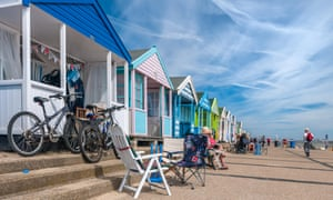 Beach huts on the promenade at Southwold. Second homes have proliferated in the town in recent years.