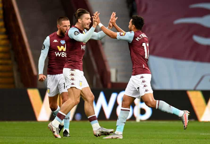 Aston Villa's Trezeguet celebrates scoring against Arsenal with Jack Grealish.