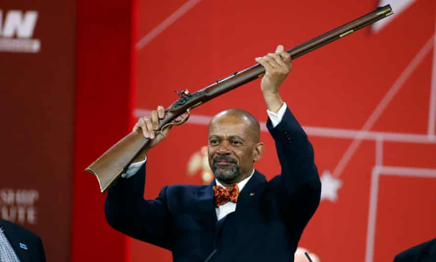 Sheriff David Clarke holds up a rifle that was presented to him as part of his Charlton Heston Courage Under Fire Award at the 2015 Conservative Political Action Conference in Maryland.