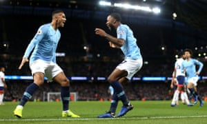 Raheem Sterling celebrates with Manchester City teammate Danilo after scoring the goal against Bournemouth which takes him joint top of the Premier League scoring charts.