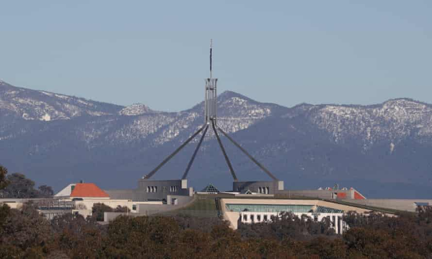 Snow on the Brindabella Ranges behind Parliament House in Canberra