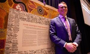 BHP boss Andrew Mackenzie poses next to the original Uluru Statement during in Perth on Thursday.