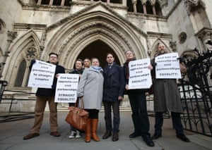Rebecca Steinfeld and Charles Keidan (centre) with supporters including Peter Tatchell (second right) outside the Royal Courts of Justice in London.