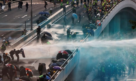 Hong Kong police fire water cannon at protesters throwing petrol bombs - video