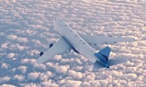 plane airborne over the sea