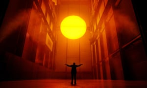 Olafur Eliasson's installation The Weather Project in the Turbine Hall of Tate Modern.