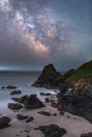 Kynance cove by nightAinsley Bennett (UK). On a family trip to Cornwall after visiting Kynance Cove, on the Lizard Peninsula, the beautiful landscape seemed to be the ideal place for the photographer to capture the glimmering stars and the striking colours of the Milky Way illuminating the beautiful rocky coastline. This is a composition of two separate exposures, one for the sky and one for the foreground blended together post-processing to achieve the desired result, producing a more even exposure.