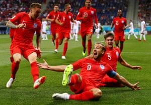 Harry Kane celebrates scoring England's first goal in their 2-1 win against Tunisia.