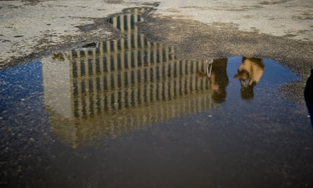 The US embassy in Havana reflected in a puddle.