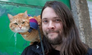 James Bowen with his adopted pet, Bob (left). Bowen believes Bob could yet make it onto the big screen: 'Who else could play him? He's such a character.'