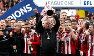 Sheffield United manager Chris Wilder and his players with the League One trophy.