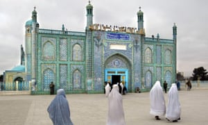 Women dressed in burqas enter the Blue Mosque of Mazar-i-Sharif in Northern Afghanistan, containing the tomb of the great commander of Islam, Amir Ul Momeineen Ali.