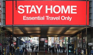 An information board in Manchester asks people to stay home.