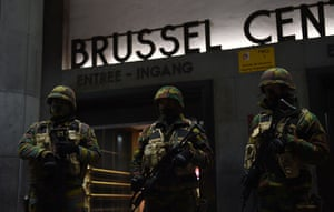 Soldiers stand guard in front of the central train station in Brussels
