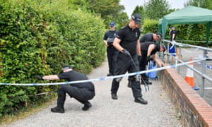 Police in Salisbury hunt for evidence in Queen Elizabeth Gardens on 19 July, after confirmation of novichok poisoning.