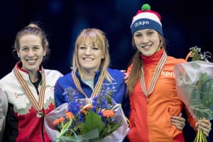 Elise Christie collects her gold medal in the 1,000m at the world championships in Rotterdam, where she also won gold in the 1500m and the overall title