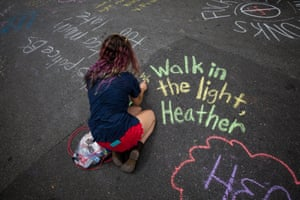 People write messages in chalk in memory of Heather Heyer