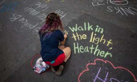 People write messages in chalk in memory of Heather Heyer.