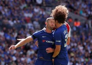 Cahill and Luiz clash.